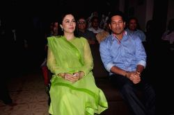 Former cricketer Sachin Tendulkar with wife Anjali Tendulkar during the launch of Dr Aparna Santhanam book Jelly Belly, in Mumbai, on Oct 28, 2015.