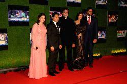 Former Indian cricket player Sachin Tendulkar with his wife Anjali Tendulkar, Bollywood actors Amitabh Bachchan, Abhishek and Aishwarya Rai Bachchan during the premiere of film Sachin: A ...