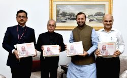 Former President Pranab Mukherjee and Union Human Resource Development Minister Prakash Javadekar during the release of  a book