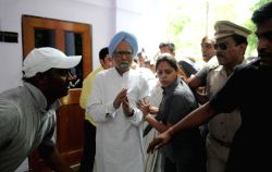 Former prime minister and Congress leader Manmohan Singh arrives to participate in
