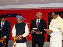 Former Prime Minister Manmohan Singh and Congress leader P Chidambaram during release of book