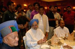 Former Prime Minister Manmohan Singh with Himachal Pradesh Chief Minister Virbhadra Singh and Congress leader AK Antony  at an Iftar party hosted by Congress president Sonia Gandhi in New ...