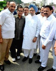 Former Prime Minster Manmohan Singh being welcomed by Vice chairman of National Commission for Scheduled Castes Raj Kumar Verka and other Congress party leaders at Amritsar on July 11, ...