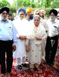 Former Prime Minster Manmohan Singh with his wife Gursharan Kaur attends a bhog ceremony of one of his relatives in Amritsar on July 11, 2015.
