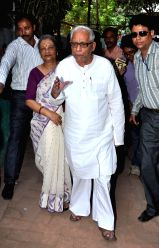 Former West Bengal Chief minister and CPI-M leader Buddhadeb Bhattacharjee with his wife at a polling booth during the fifth phase of West Bengal Legislative Assembly polls in Kolkata, on ...