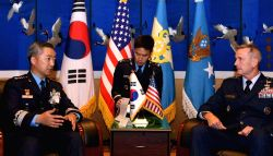 Gen. Lee Wang-keun (L), the Air Force chief of staff, speaks with Gen. Terrence O'Shaughnessy, commander of the U.S. Pacific Air Forces, during their meeting at a hotel in Seoul on Oct. 16, ...
