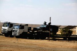 GIZA, Oct. 21, 2017 - Egyptian security forces block the road at the site about 35 kilometers away from where policemen were killed in a shootout with terrorists, in Giza, Egypt, Oct. 21, 2017. A ...