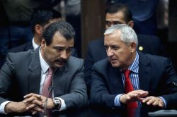 Guatemala's President Otto Perez Molina (R) appears in court with his lawyer Cesar Calderon (L) to face corruption charges against him in Guatemala City, ...