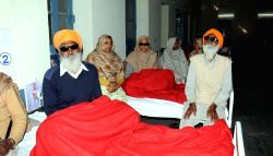 Gurdaspur: People who lost their vision after undergoing eye surgery at an eye camp organised by an NGO in Gurdaspur district of Punjab  on Dec 5, 2014. At least 15 people lost their vission after ...