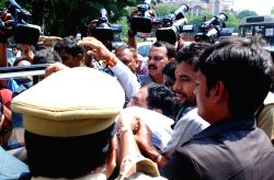 Hyderabad: Security personnel take away TDP legislators who were earlier suspended from the Telangana assembly for the entire budget session in Hyderabad, on March 26, 2015.