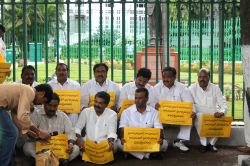 Hyderabad: TDP legislators stage a sit-in at the statue of Mahatma Gandhi in the Telangana Assembly premises to protest suspension of 10 party legislators from the assembly in Hyderabad, on Nov 13, ..