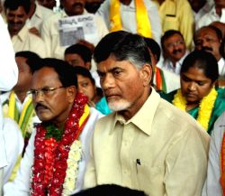 Hyderabad: TDP MLA M Narasimhulu during fasting accompanied by Andhra Pradesh Chief Minister N Chandrababu Naidu in favour of the Centre`s decision to name the domestic terminal of Rajiv Gandhi ...
