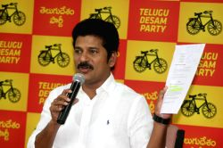 Hyderabad: TDP MLA Revanth Reddy addresses a press conference in Hyderabad on Dec. 13, 2014.