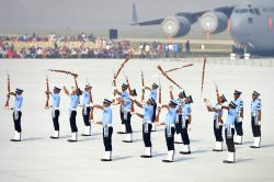 Indian Air Force personnel perform a drill with rifles during 85th Air Force Day parade at Hindon Air Force base in Ghaziabad on Oct 8, 2017.