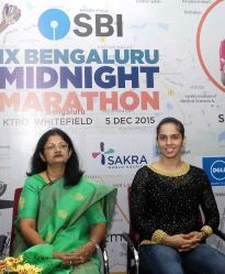 Indian badminton player Saina Nehwal with SBI chief general manager Rajni Mishra during a press conference in Bengaluru, on Oct 7, 2015.