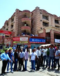 People rush out of their offices as tremors were felt in Jaipur on April 25, 2015. According to the India Meteorological Department, the depth of earthquake was 10 km and measured 6 on the ...