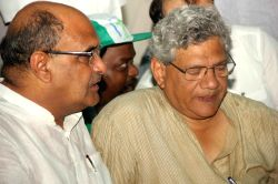 JD(U) General Secretary KC Tyagi  and CPI-M General Secretary Sitaram Yechury during a demonstration against land acquisition law at Jantar Mantar in New Delhi, on July 27, 2015.