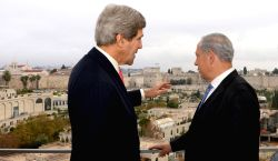 JERUSALEM, Dec. 6, 2013 (Xinhua/IANS) -- Visiting U.S. Secretary of State John Kerry (L) talks with Israeli Prime Minister Benjamin Netanyahu in Jerusalem, on Dec. 6, 2013. Kerry concluded his visit to Israel and Palestinian territories on Friday noon, leaving behind what seems to be unbridgeble gaps between Israel and the Palestinians amid the faltering peace talks. (Xinhua/GPO/Haim Zach)