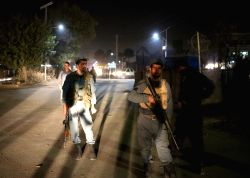 KABUL, Oct. 21, 2017 - Afghan security force members stand at the site of an attack in Kabul, capital of Afghanistan, Oct. 21, 2017. At least 15 army cadets were killed and four others wounded as ...