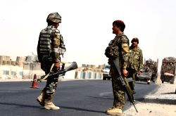 KANDAHAR, Oct. 19, 2017 - Afghan army soldiers stand guard at a security checkpoint after Taliban attack near the Maywand district of Kandahar province, Afghanistan, Oct.19, 2017. Forty-three Afghan ...
