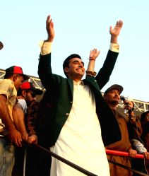 Karachi: Bilawal Bhutto Zardari (C), chairman of Pakistan Peoples Party (PPP), waves to supporters as he arrives for a public gathering in southern Pakistani port city of Karachi on Oct. 18, 2014. ...