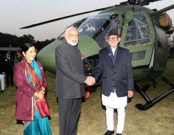 Kathmandu: Prime Minister Narendra Modi hands over the Dhruv ALH to the Prime Minister of Nepal, Sushil Koirala, at Army Pavilion, in Kathmandu, Nepal, on Nov 25, 2014. Also seen  Union Minister for .