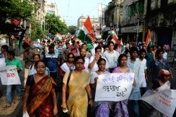 Kolkata: Congress workers participate in `Lalbazar Abhiyan` to protest against violence during KMC polls in Kolkata on April 21, 2015.