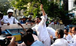Kolkata: Congress workers try to break the police barricades during `Lalbazar Abhiyan` to protest against violence during KMC polls in Kolkata on April 21, 2015.