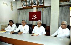 Kolkata: CPI-M General Secretary Sitaram Yechury with West Bengal CPI-M Secretary Surjya Kanta Mishra, former chief minister of  West Bengal Buddhadeb Bhattacharjee and former CPI-M general secretary ...