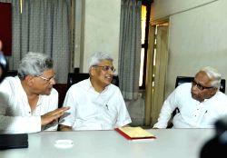 Kolkata: CPI-M General Secretary Sitaram Yechury with former chief minister of  West Bengal Buddhadeb Bhattacharjee and former CPI-M general secretary Prakash Karat during party's West Bengal ...