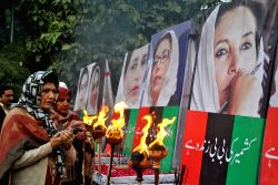 Supporters of slain premier Benazir Bhutto pray as they gather on the sixth anniversary of Bhutto's assassination, at a rally in eastern Pakistan's Lahore .