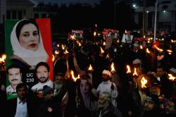 LAHORE, Dec. 28, 2013 (Xinhua) -- Supporters of slain premier Benazir Bhutto hold torches on the sixth anniversary of Bhutto's assassination, at a rally in eastern Pakistan's Lahore on Dec.