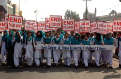 Lahore: Pakistani students hold placards during a rally to mark World Polio Day