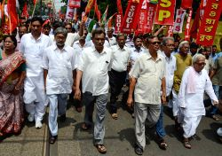 Left Front chairman Biman Bose, CPI-M leader and Leader of Opposition in West Bengal Assembly Surya Kant Mishra and others participate in a rally during the nationwide strike called by ...