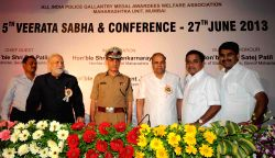 Maharashtra Governor K. Shankarnarayanan, Home Minister R R Patil, Commissionar of Police Dr Satyapal Singh at a conference organised by All India Police Gallantry Medal Awards Welfare Association at Police Club in Mumbai on June 27, 2013. (Photo: Sandeep Mahankal/IANS)