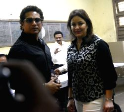 Master Blaster Sachin Tendulkar with wife Anjali Tendulkar cast their vote on the polling day of Lok Sabha Elections 2014 in Mumbai on April 24, 2014. (Photo Sandeep Mahankal/IANS)