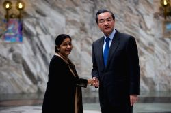 MOSCOW, April 18, 2016 - Chinese Foreign Minister Wang Yi (R) meets with Indian External Affairs Minister Sushma Swaraj in Moscow, capital of Russia, on April 18, 2016.