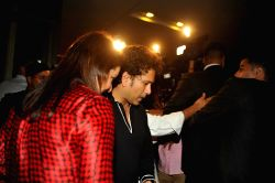 Indian cricketer Sachin Tendulkar along with his wife Anjali Tendulkar arrives for felicitation ceremony of cricketer Rohit Sharma who hit a world-record double century in Mumbai, on November