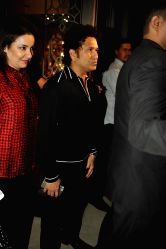 Mumbai: Indian cricketer Sachin Tendulkar along with his wife Anjali Tendulkar arrives for felicitation ceremony of cricketer Rohit Sharma who hit a world-record double century in Mumbai, on November
