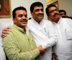 Mumbai: Newly elected Maharashtra Congress chief Ashok Chavan and Mumbai Congress chief Sanjay Nirupam  in Mumbai, on March 2, 2015.