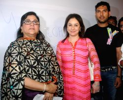 Mumbai: Rita Gupta (Vice President of Maharashtra Nav Nirman Sena - MNS) with Dr. Anjali Tendulkar and Yuvraj Singh during the Cancer awareness event on the occasion of International Women`s Day by ...
