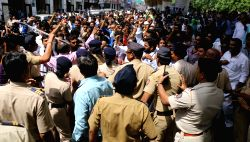 Nagpur : Police stop dalit community members demonstration against Congress MP Vijay Darda and his regional newpaper after it published an article on reservation policy near Lokmat Square in Nagpur, ...