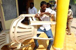 Nalgonda: Alleged TRS workers vandalise TDP office in Nalgonda district of Telangana on Oct.21, 2014.