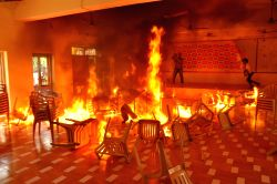 Nalgonda: Furnitures set on fire at TDP office by alleged TRS workers in Nalgonda district of Telangana on Oct.21, 2014.