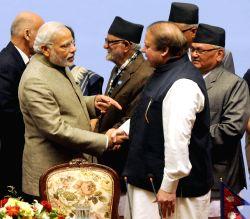 Nepal: PM Modi shakes hands with Nawaz Sharif at the 18th SAARC Summit