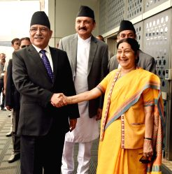 Nepalese Prime Minister Pushpa Kamal Dahal being received by the Union Minister for External Affairs Sushma Swaraj, on his arrival, in New Delhi on Sept 15, 2016.