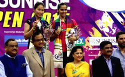 New Delhi: Ace shuttler Saina Nehwal with Thai badminton player Ratchanok Intanon after winning the women's singles title of the India Open Superseries at the Siri Fort Sports Complex in New Delhi, ...