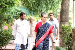 Congress president Sonia Gandhi, vice president Rahul Gandhi and party leader Dr. Manmohan Singh arrive to attend a party meeting in New Delhi, on June 9, 2015.