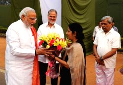 New Delhi: External Affairs Minister, Sushma Swaraj greets Prime Minister Narendra Modi on his arrival at Rajpath for Rashtriya Ekta Diwas celebrations in New Delhi on Oct. 31, 2014. Also seen Delhi .