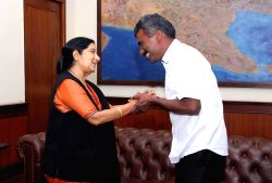 New Delhi: External Affairs Minister Sushma Swaraj welcomes back Father Alexis Premkumar Antonysamy on his return to India after spending eight months in captivity in Afghanistan; in New Delhi, on ...